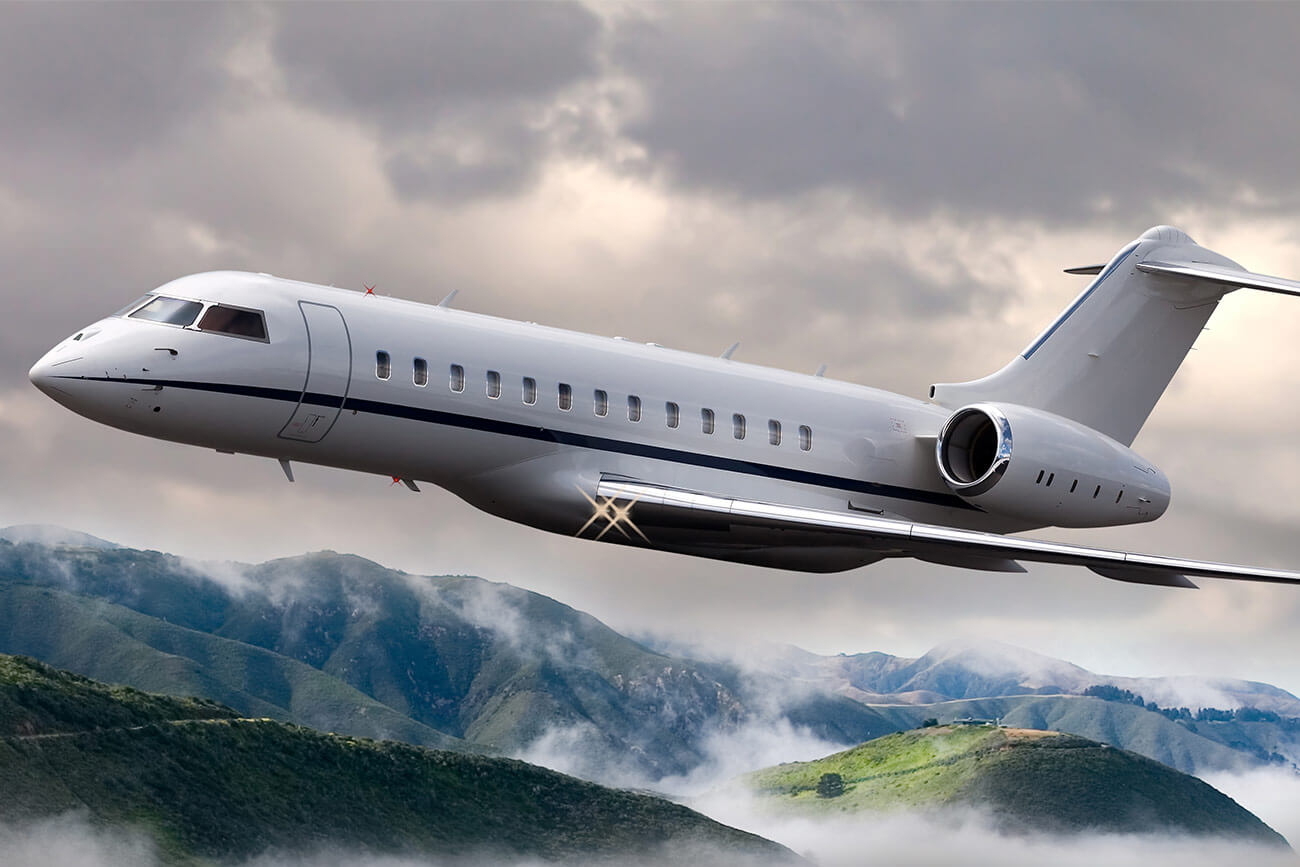 Private jet flying over mountains